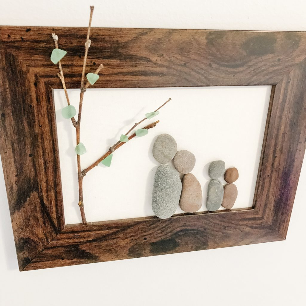 rock family art in gallery wall using pebble and sea glass
