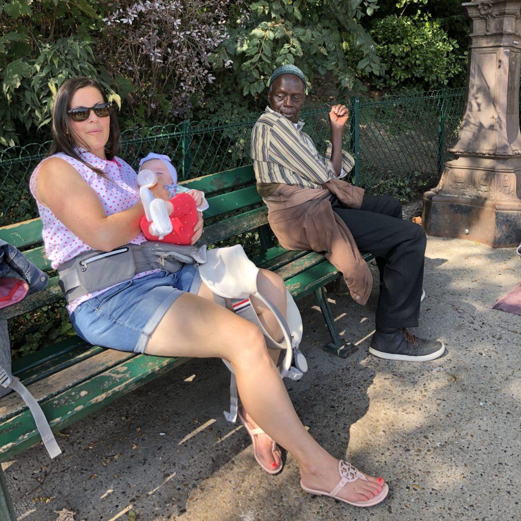 Mom feeding baby on park bench