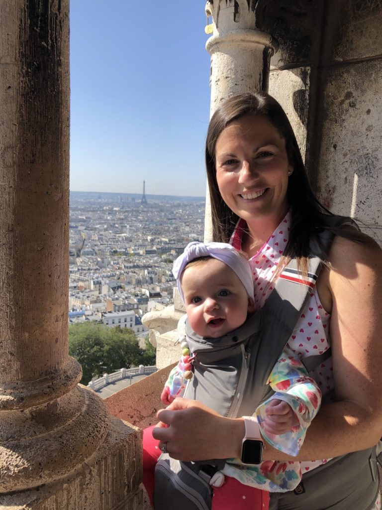 Mom with baby and view of the Eiffel Tower